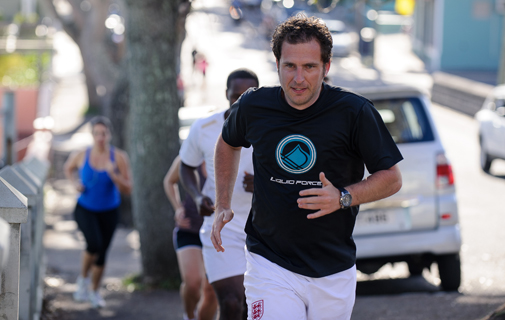 The Bermuda Sun's James Burton heads down Victoria Street, closely followed by other members of the Run Strong group. *Photo by Kageaki Smith
