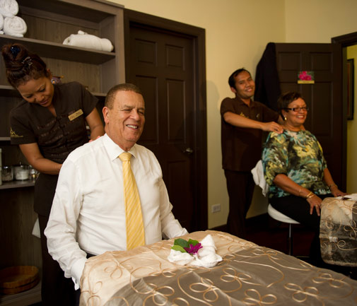 Sir John Swan gets a massage during the spa's grand opening. *Photo by Kageaki Smith