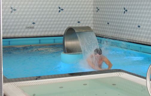 A man uses the hydrotherapy pool in the spa.  *Photo by Don Burgess