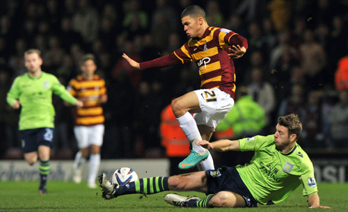 Nahki Wells in action against Aston Villa during the Capital One Cup semi-final last season. *AFP photo.