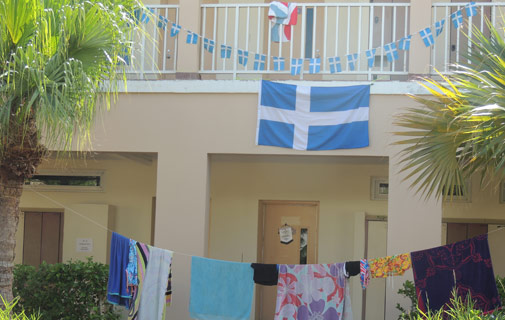 Clothing is hanging over the railings and adorning makeshift clotheslines at CedarBridge Academy as the school serves as the main Island Games village. Country pride can be seen as multiple flags were waving gently in the breeze Friday afternoon. *Photo by Don Burgess