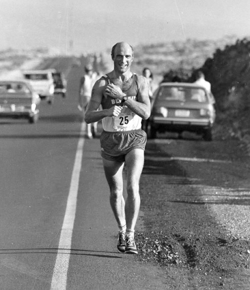 Gerry Benson manages a smile despite being well into the third and final section of the 1981 Ironman, the marathon. *Photo supplied