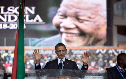 Tribute: President Obama drew rapturous applause yesterday at the funeral of Nelson Mandela in Soweto. *AFP photo