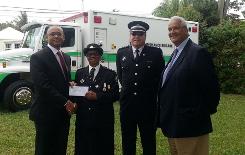 BELCO COO Denton E. Williams presents a cheque for $10,000 to Ms. Shirley Outerbridge who is the longest-serving member of St. John Ambulance Brigade in Bermuda; also present to accept the donation were Assistant Commissioner Gareath Adderley and Chairman Michael King. *Photo supplied
