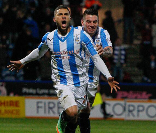 Nahki Wells celebrates his Huddersfield Town goal debut on Saturday. *Photo courtesy of Twitter @htafcdotcom