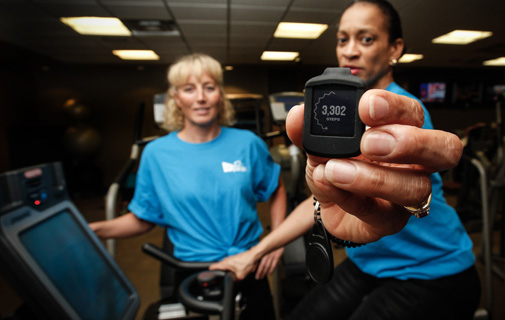 Lisa Blackburn, Colonial's Wellness Coordinator in Bermuda and Cammie Simmons, a Colonial wellness champion, show the Virgin Pulse Max device. *Photo supplied