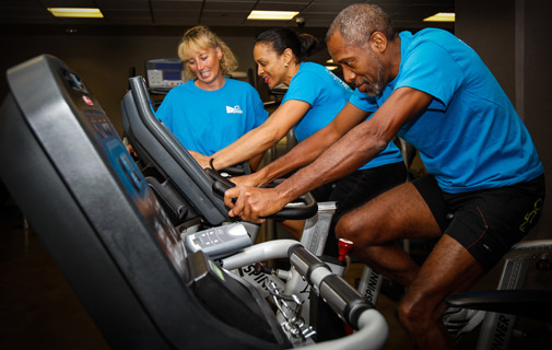 Left to right: Lisa Blackburn, Colonial's Wellness Coordinator in Bermuda, puts Cammie Simmons and Kevin James, both Colonial wellness champions, through their paces as part of the Virgin Pulse programme. *Photo supplied