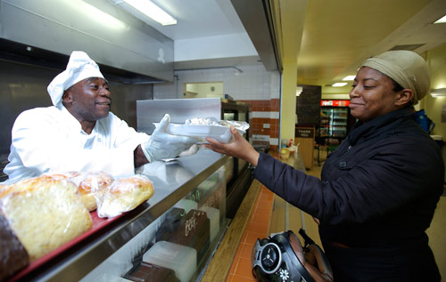 Hot and tasty: Sous-chef Jeffery Harper serves a customer at Peppino's Cafe. *Photo by Nicola Muirhead