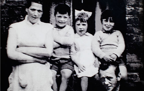 A family photograph showing her mother Jean McConville, left, and some of Jean's children including Helen McKendry, second right. *AFP photo
