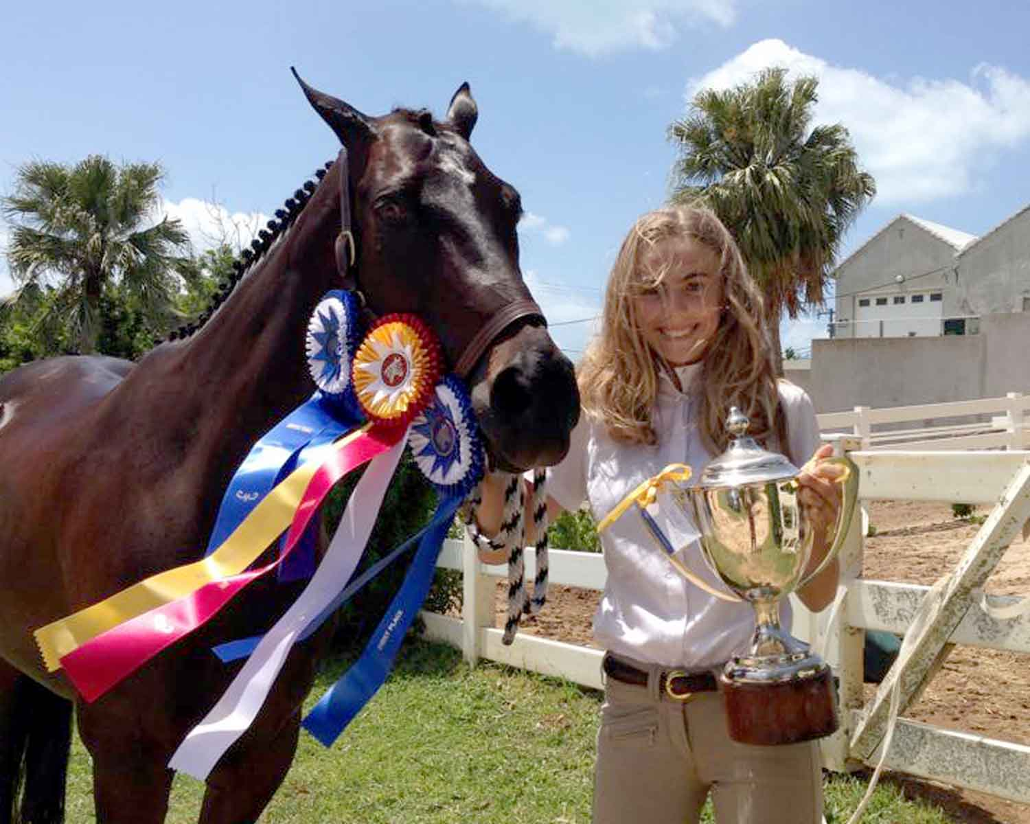 Arden and Dancer with their trophy and ribbon haul from this year's Agricultural Exhibition.