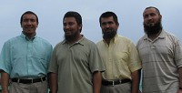 New image: Four Uighars, above, sporting heavy beards and below, with their new clean-shaven look (their island guide Glenn Brangman is second from left).