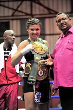 Accessorize: Teresa Perozzi knows how to stylize her boxing attire with title belts from the WBC and WBC. She'll get a chance to fight for the WBC belt against Tori Nelson as she is the number one contender. *Photo courtesy of the Trinidad Express
