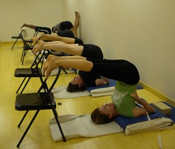 Students in the final stages of Salamba sarvangasana (Shoulder stand). *Photo by Amanda Dale